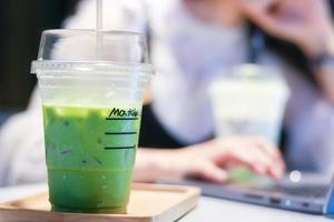 Iced matcha green tea latte photo