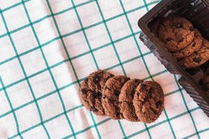 Chocolate cookies on kitchen cloth background