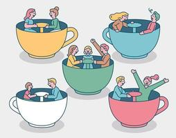 People are riding tea cups in an amusement park. The family and couple are having fun sitting in tea cups.