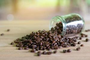 Roasted coffee beans in glass bottles