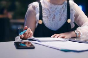 Woman writing notes at a desk