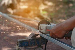 Technician cutting steel