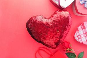 Heart shaped gift on red background photo
