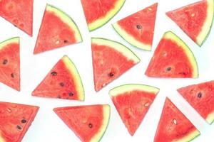 Watermelon slices on white background photo