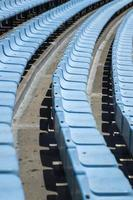 Closeup detail of the blue stadium seats photo