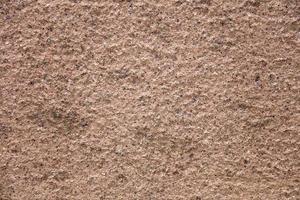 antiguo muro de piedra rosa