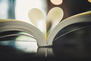 Curled paper heart shape with blurred bokeh of cafe photo