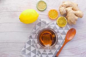 Top view of ginger tea on wooden background