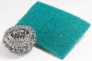 Green scrub sponge and silver pot sponge for cleaning photo