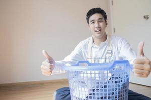 Asian man folding laundry
