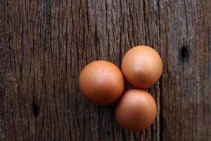 Hen eggs on wood background