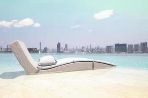 Rattan chairs beside swimming pool photo