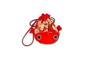 Bolsa de pescado rojo aislado en blanco foto