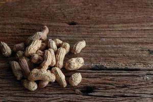 Peanuts on a wooden background