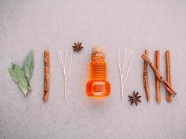 Bottle of essential oil flat lay photo