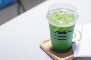 Iced matcha green tea latte on a table
