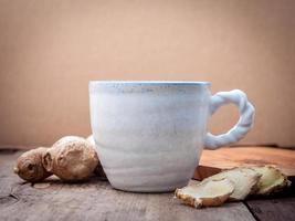 Ginger tea on a wooden background