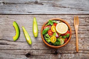 Salad bowl on wood