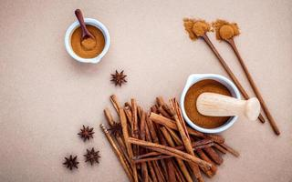 Cinnamon and anise on a brown background
