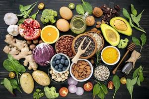 Top view of healthy foods on a dark stone background