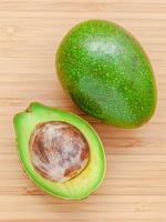 Fresh sliced avocado on wooden background