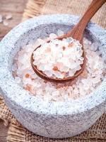 Himalayan sea salt in a mortar and a spoon photo