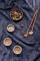 Chrysanthemum tea on blue cloth photo