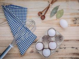 Eggs with cooking utensils