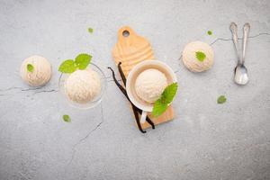 Vanilla ice cream on a gray background