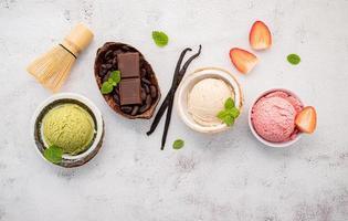 Multiple kinds of ice cream on concrete photo