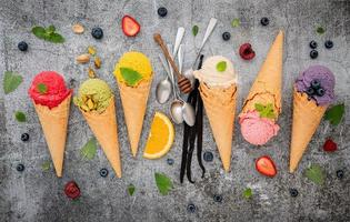 Colorful ice cream in cones on a concrete background
