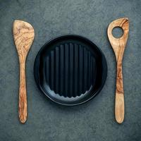 Plate and wooden cooking utensils