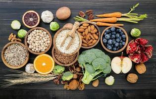 Top view of healthy foods on dark wood
