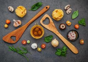Top view of Italian ingredients on a dark gray background