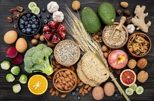 Top view of healthy foods on a dark wood background photo