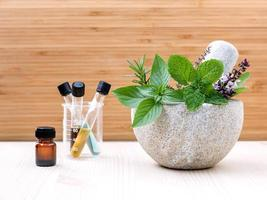 Essential oils and fresh herbs photo