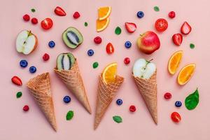 Colorful fruit and waffle cones