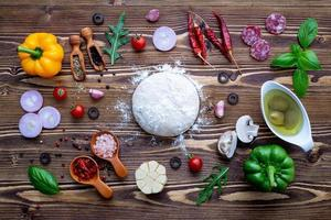 Top view of pizza dough and toppings photo