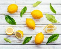 Fresh lemons on a shabby white background