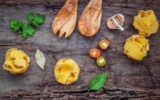 Wooden utensils and Italian ingredients