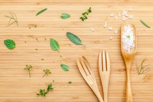 Aromatic herbs and spices with forks photo