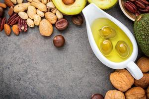 Olive oil and nuts photo