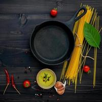 Frying pan and ingredients for spaghetti