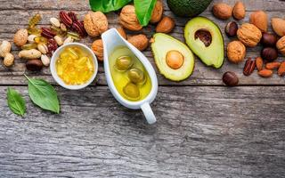 Omega 3 and unsaturated fats rich foods on wood