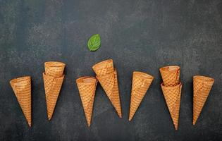 Waffle cones on a dark gray background