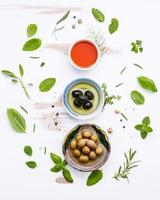 Top view of cooking oils and herbs photo