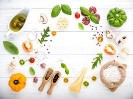 Fresh ingredients on a white wooden background photo