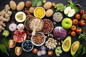 Pile of healthy food on a dark background photo