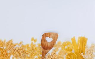 Wooden spoon and pasta