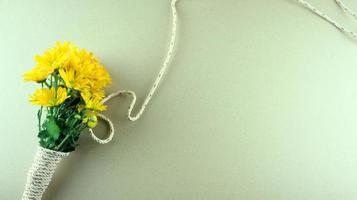 Flat lay of a bouquet of yellow mums or Chrysanthemum flowers